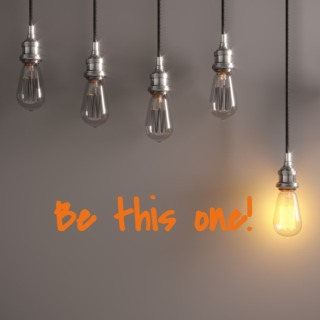 glowing-light-bulb-standing-out-from-the-crowd-picture-id1139703398